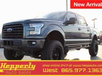 This 2015 Ford F-150 XLT in Guard Metallic features.