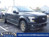CARFAX One-Owner. Black 2015 Ford F-150 XLT 4WD 6-Speed