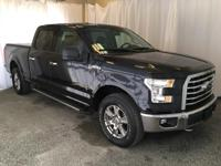 This 2015 Ford F-150 XLT comes equipped with a backup
