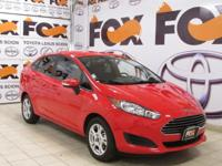 This outstanding example of a 2015 Ford Fiesta SE is