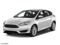 This 2015 Ford Focus SE is complete with top-features