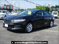 This 2015 Ford Fusion SE boasts features like a backup