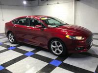 2015 Ford Fusion SE In Ruby Red Tinted Clearcoat.