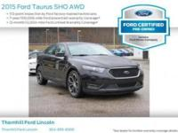 Grand and graceful, this 2015 Ford Taurus practically