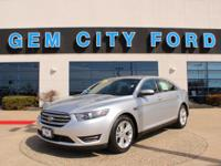 Ingot Sliver Metallic 2015 Ford Taurus SEL with a 2.0 L