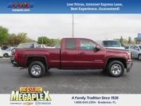 This 2015 GMC Sierra 1500 SLE in Sonoma Red Metallic is