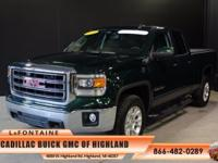 2015 GMC Sierra 1500 SLE in Emerald Green Metallic.