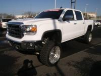 This outstanding example of a 2015 GMC Sierra 1500 SLT