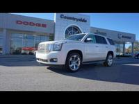Treat yourself to this 2015 GMC Yukon Denali, which