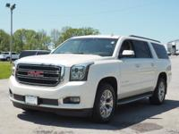 Treat yourself to this 2015 GMC Yukon XL SLT, which