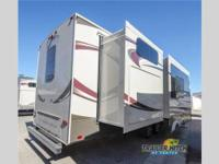 This 2015 Solitude 366DEN 5th Wheel is unlike any