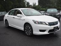This outstanding example of a 2015 Honda Accord Hybrid