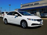This is a 2015 Honda Civic 4dr CVT LX . Low miles for a