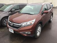 This outstanding example of a 2015 Honda CR-V EX-L is