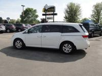 A very nice one-owner, off lease, 8-passenger van with