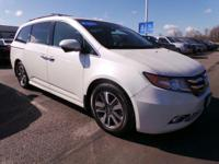 Look at this 2015 Honda Odyssey Touring. Its Automatic