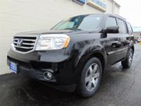 This Honda Pilot Touring is a great pre-owned car.