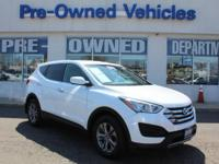 This outstanding example of a 2015 Hyundai Santa Fe