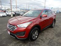You are looking at a 2015 Hyundai Santa Fe Sport.  This