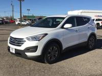 This car sparkles!! This handy Santa Fe Sport, with its