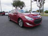 This 2015 Hyundai Sonata Hybrid Limited in Red