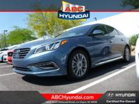 Beige w/Leather Seating Surfaces, ABS brakes, Alloy
