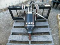 COMES MOUNTED ON A SKID STEER BRACKET WITH HOSES. Skid
