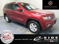 This 2015 Jeep Grand Cherokee Laredo is Deep Cherry Red