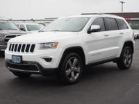 This WHITE 2015 Jeep Grand Cherokee Limited might be