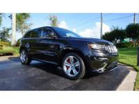 This 2015 Jeep Grand Cherokee is featured in Brilliant