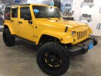 2015 Jeep Wrangler Unlimited Sport upgraded to Sahara