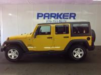 This 2015 Jeep Wrangler Unlimited Sport is proudly