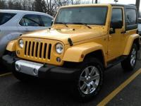 This one owner, 2015 Jeep Wrangler has alloy wheels, a