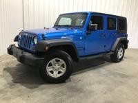 From mountains to mud, this Blue 2015 Jeep Wrangler
