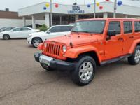 This 2015 Jeep Wrangler Unlimited Sahara is proudly