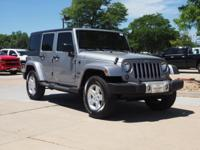 This 2015 Jeep Wrangler Unlimited Sahara at Century