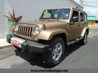 Check out this 2015 Jeep Wrangler Unlimited Sahara. Its