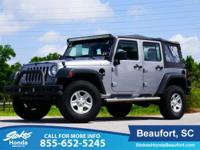 2015 Jeep Wrangler in Gray. Like new. Hybrid-like fuel
