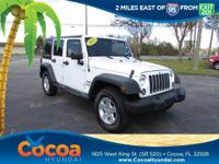 This 2015 Jeep Wrangler Unlimited Sport in White