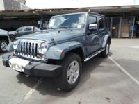 Look at this 2015 Jeep Wrangler Unlimited . Its Manual