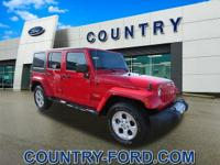 This 2015 Jeep Wrangler Unlimited Sahara is a real