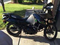 Brand new condition 2015 KLR 650 dual sport motorcycle.