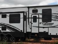 2015 Keystone FUSION 404, Featuring a 12 garage with