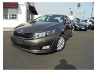 This is a beautiful BROWN 2015 KIA OPTIMA 4 DOOR SEDAN