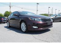 For a smoother ride, opt for this 2015 Kia Optima LX