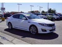 Optima, with less than 12k miles, pretty much brand