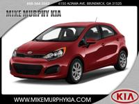 This 2015 Kia Rio5 LX features a a power outlet, hill