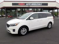 Safe, worry-free and spacious, this used 2015 Kia