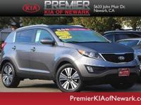 This 2015 Kia Sportage EX is offered to you for sale by