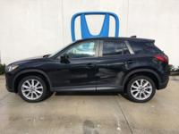 Come see this 2015 Mazda CX-5 Grand Touring. Its